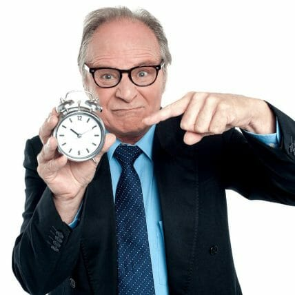 waiting for credit repair - senior citizen pointing at clock